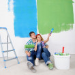 Happy young cople relaxing after painting in new home — Stock Photo #11270643