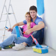 Royalty-Free Stock Photo: Happy young cople relaxing after painting in new home
