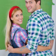 Happy couple paint wall at new home — Foto Stock