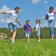 Royalty-Free Stock Photo: Happy young family have fun outdoors