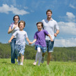 Happy young family have fun outdoors — Stock Photo #11696929