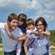 Happy young family have fun outdoors — Stock Photo #11700146