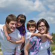 Happy young family have fun outdoors — Stock Photo #11700188