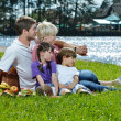 Happy family playing together in a picnic outdoors — Stock Photo #11701706