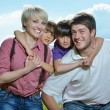 Happy young family have fun outdoors — Stock Photo #11702803