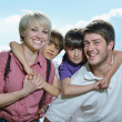 Happy young family have fun outdoors — Stock Photo #11702822