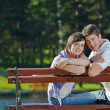 Portrait of romantic young couple smiling together outdoor - Stock Photo