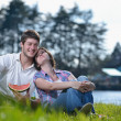 Happy young couple having a picnic outdoor — Stock Photo #11704903