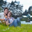 Happy young couple having a picnic outdoor — Stock Photo #11704948