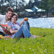 Happy young couple having a picnic outdoor — Stock Photo #11704996