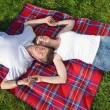 Happy young couple having a picnic outdoor — Stock Photo #11705194