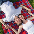 Happy young couple having a picnic outdoor — Stock Photo #11705418