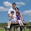 Happy young family have fun outdoors — Stock Photo #11708594