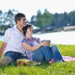 Happy young couple having a picnic outdoor — Stock Photo #11709190