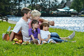 Happy family playing together in a picnic outdoors — Stock Photo