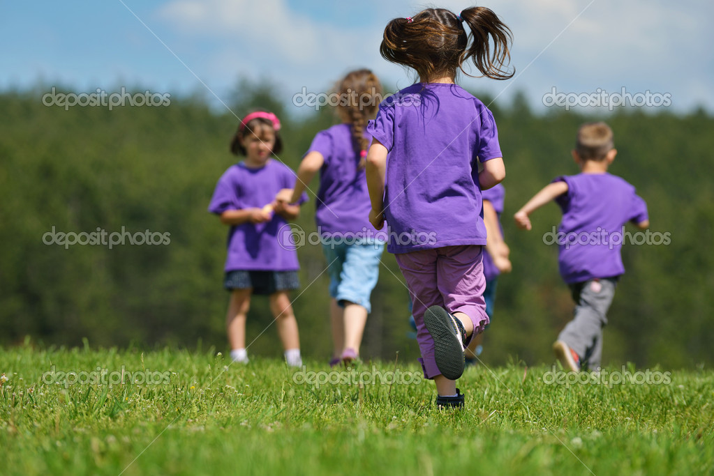 Happy kids group have fun in nature outdoors park — Stock Photo #11734574