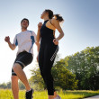 Young couple jogging — Stock fotografie