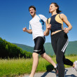 Young couple jogging — Stock Photo #11936646