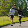 Couple doing stretching exercise  after jogging — Zdjęcie stockowe