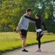 Couple doing stretching exercise after jogging — Stock fotografie