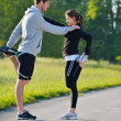 Royalty-Free Stock Photo: Couple doing stretching exercise  after jogging