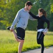 Couple doing stretching exercise  after jogging — Stock Photo