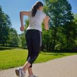 Young beautiful woman jogging — Stock Photo #11936896