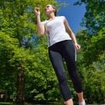 Young beautiful woman jogging — Stock Photo #11936900
