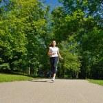 Young beautiful woman jogging — Stock Photo #11936903