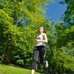 Young beautiful woman jogging — Stock Photo #11936910