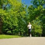 Young beautiful woman jogging — Stock Photo #11936916
