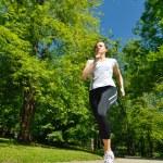 Young beautiful woman jogging — Stock Photo #11936921