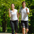 Stock Photo: Young couple jogging