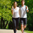 Young couple jogging — Stok fotoğraf