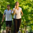 Young couple jogging — Foto Stock