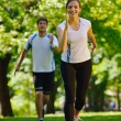 Young couple jogging — Stock Photo #11937069