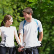 Royalty-Free Stock Photo: Happy couple riding bicycle outdoors
