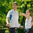 Happy couple riding bicycle outdoors — Foto de Stock