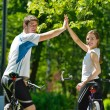 Happy couple riding bicycle outdoors — Stock Photo #11937203
