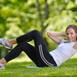 Woman stretching before fitness — Stock Photo