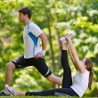 Couple doing stretching exercise after jogging — Stock Photo #11937417
