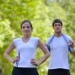Couple doing stretching exercise  after jogging - Stock Photo