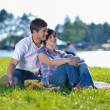 Happy young couple having a picnic outdoor — Stock Photo #11938364