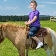 Child ride pony — Stockfoto