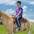 Child ride pony — Stock Photo #11938583