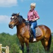 Royalty-Free Stock Photo: Happy woman  ride  horse