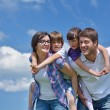 Happy young family have fun outdoors — Stok fotoğraf