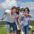 Happy young family have fun outdoors — Stock Photo #11939087