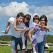 Happy young family have fun outdoors — Stock Photo #11939092