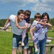 Happy young family have fun outdoors — Stock Photo #11939097